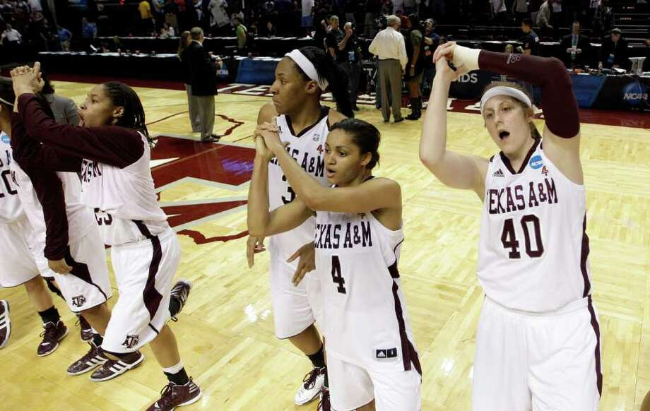 Texas A&M's Kelsey Assarian (40), Sydney Carter (4), Kelsey Bone (3) and Skylar Collins (25) celebrate with teammates after defeating Albany in an NCAA tournament first-round college basketball game on Saturday, March 17, 2012, in College Station, Texas. Texas A&M won 69-47.  (AP Photo/David J. Phillip) Photo: David J. Phillip, Associated Press / AP