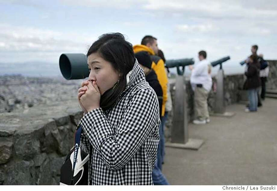 cold14_031_ls.jpg Maiko Shirahata of Boston, MA tries to warm up her hands as she takes in the view from atop of Twin Peaks in San Francisco where she visited with her friend, Minjung Song also of Boston, MA. Don�t lose your sweater or umbrella -- another week of cold, showery weather could be ahead. A low-pressure cell of cold, unstable air from off the Gulf of Alaska has settled down for the interim off California, and it�s expected to hang around for a week or so longer, a leading Bay Area meteorologist says. At the moment, average Bay Area temperatures in recent days have been on the order of 15 degrees below normal. Six weeks ago, federal forecasters anticipated a warmer, drier-than-normal February-to-April for the region. They might not have been too far wrong, local meteorologist Jan Null said. These kinds of extreme up-and-down temperature trends tend to average out in the long run, and people tend to remember only the extremes. After all, February had some unusually warm days, he pointed out.  Photo taken on 3/13/06 in San Francisco, CA. Photo by Lea Suzuki/ The San Francisco Chronicle MANDATORY CREDIT FOR PHOTOG AND SF CHRONICLE/ -MAGS OUT. Photo: Lea Suzuki