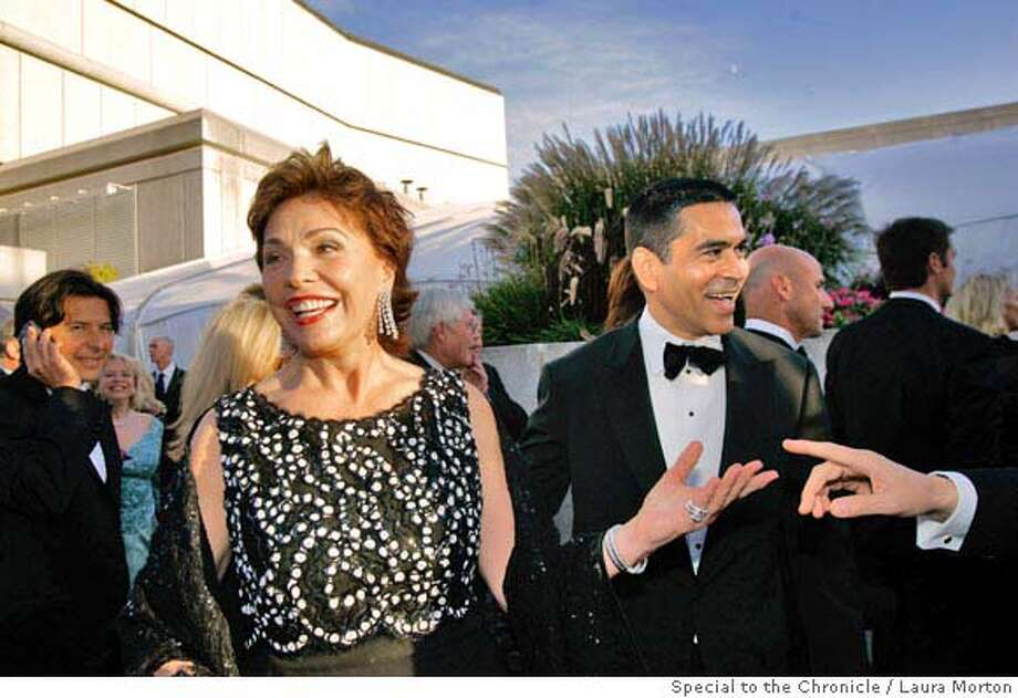 Symphony21_0330_LKM.jpg Maria Manetti Farrow (center) and Daniel Diaz (right) make their way towards the patron's tent during the San Francisco Symphony Opening Night Gala. (Laura Morton/Special to the Chronicle) *** Maria Manetti Farrow  *** Daniel Diaz Photo: Laura Morton