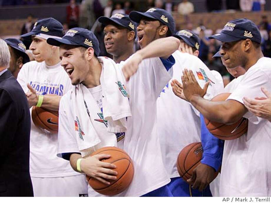UCLA's Jordan Farmar, second from left, celebrates with members of his team after winning the Pac-10 conference basketball tournament final game against California, Saturday, March 11, 2006, in Los Angeles. UCLA won, 71-52. (AP Photo/Mark J. Terrill) Photo: MARK J. TERRILL