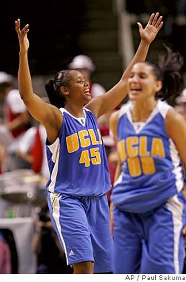 UCLA guard Noelle Quinn (45) celebrates with guard Ortal Oren (00) after UCLA defeated Stanford 85-76 in overtime in the finals of the Pac-10 basketball tournament in San Jose, Calif., Monday, March 6, 2006. Quinn was UCLA's top scorer with 22 points. (AP Photo/Paul Sakuma) Photo: PAUL SAKUMA