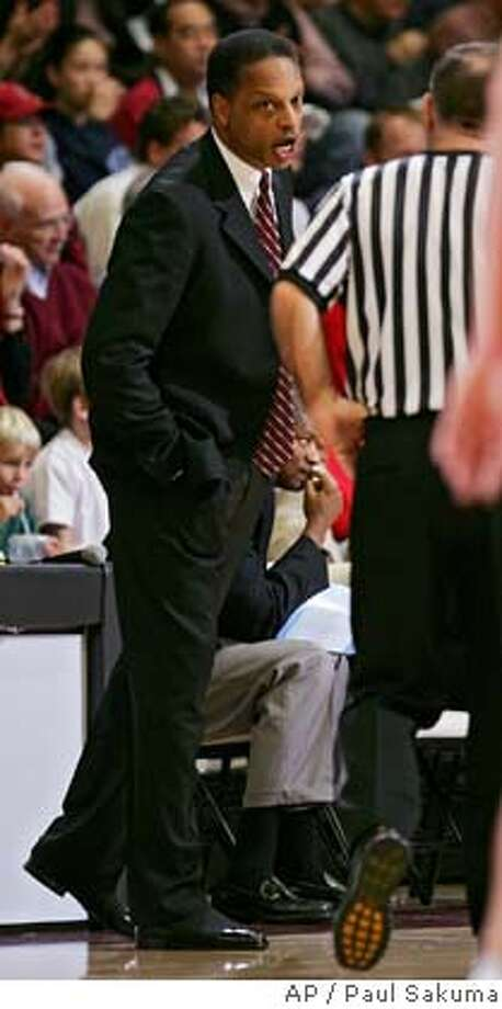 Stanford head coach Trent Johnson, left, argues with an official in the second half in NCAA basketball action against Arizona, Sunday, Feb. 19, 2006 in Stanford, Calif. Arizona defeated Stanford 76-72. (AP Photo/Paul Sakuma) EFE OUT EFE OUT Photo: PAUL SAKUMA