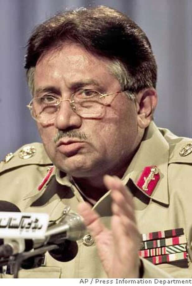 An undated handout photo from Pakistan's Press Information Department shows Pakistan's President Gen. Pervez Musharraf as he addresses a news conference in Islamabad, Pakistan. Al-Qaida chief Osama bin Laden called on Pakistanis to rebel against Musharraf in a new audiotape released on Thursday Sept. 20 2007 , saying his military's siege of a militant mosque stronghold this year makes him an infidel. (AP Photo/Press Information Department,HO) UNDATED HANDOUT PHOTO FROM PAKISTAN'S PRESS INFORMATION DEPARTMENT Photo: HO