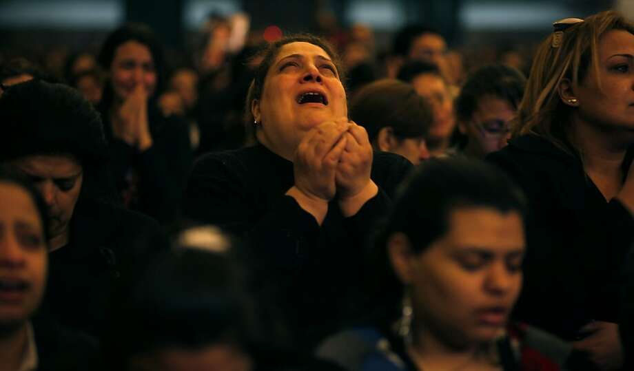 Egyptian women mourn for Pope Shenouda III, the patriarch of the Coptic Orthodox Church, Saturday, March 17, 2012 at the cathedral in Cairo, Egypt. Pope Shenouda III who led Egypt's Christian minority for 40 years during a time of increasing tensions with Muslims, has died. He was 88. Photo: Khalil Hamra, Associated Press