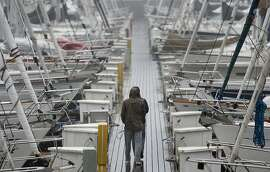 Rain beats down onto rows of sailboats in the harbor at Sausalito on Friday, March 16, 2012.