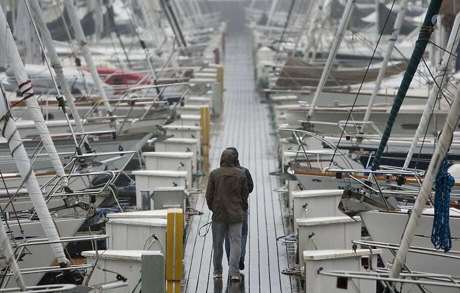 Rain beats down onto rows of sailboats in the harbor at Sausalito on Friday, March 16, 2012. Photo: Kevin Johnson, The Chronicle
