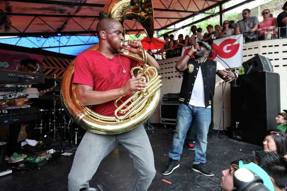 "The Roots' Damon ""Tuba Gooding Jr.""  (left) and Tariq ""Black Thought"" Trotter perform with the band at the Mohawk during South by Southwest Saturday March 17, 2012 in Austin, TX. Photo: EDWARD A. ORNELAS, SAN ANTONIO EXPRESS-NEWS / © SAN ANTONIO EXPRESS-NEWS (NFS)"