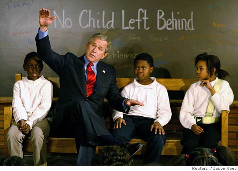 """U.S. President George W. Bush talks to fourth graders at Pierre Laclede Elementary school in St Louis, Missouri January 5, 2004. Bush paid a visit to the school to talk about his administration's """"No Child Left Behind """" education policy on the second anniversary of the plan. REUTERS/Jason Reed 0 President Bush talks to fourth-graders at Pierre Laclede Elementary School in St. Louis. President Bush talks to fourth-graders at Pierre Laclede Elementary School in St. Louis. Nation#MainNews#Chronicle#1/6/2004#ALL#3star##0421555532 Photo: JASON REED"""