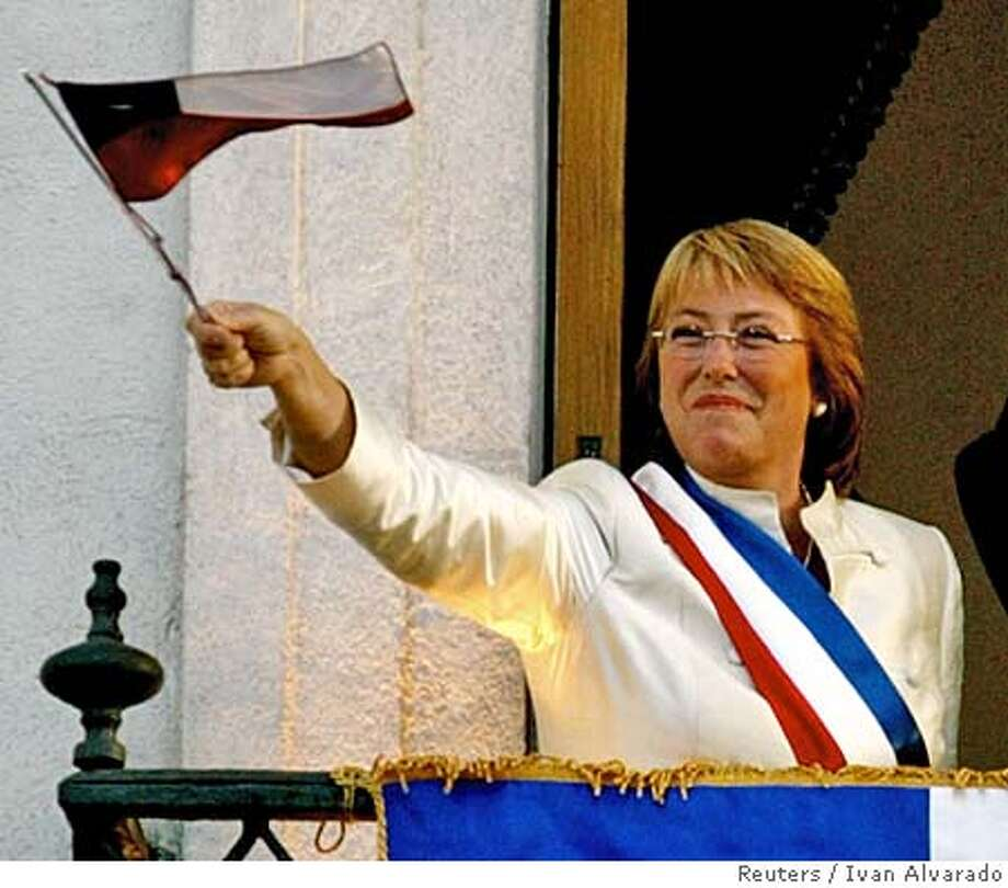 Chile's President Bachelet waves a national flag in Santiago Photo: IVAN ALVARADO