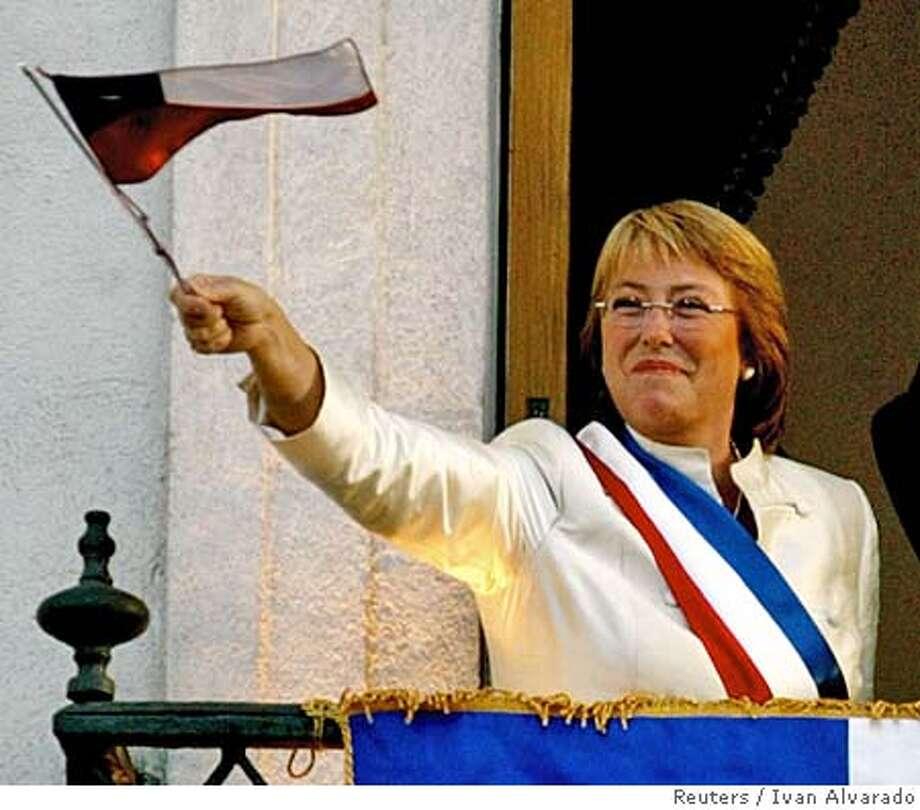 Chile's President Bachelet waves a national flag in Santiago Photo: IVAN ALVARADO