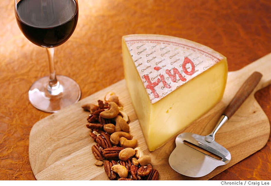 CHEESE21_003_cl.JPG  Photo of Chiantino, a washed-rind cow�s milk cheese from southern Germany, alongside a glass of Pinot Noir wine. Food styled by Cindy Lee.  on 9/17/07 in San Francisco. photo by Craig Lee / The Chronicle MANDATORY CREDIT FOR PHOTOG AND SF CHRONICLE/NO SALES-MAGS OUT Photo: Photo By Craig Lee