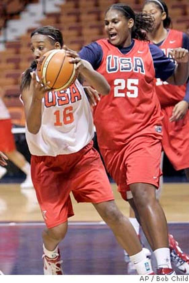 Courtney Paris pursues Candice Wiggins, left, during practice for the USA Basketball women's national team in Uncasville, Conn., Tuesday, Sept. 18, 2007. The U.S. team will play Australia on Wednesday in Uncasville. (AP Photo/Bob Child) Photo: Bob Child