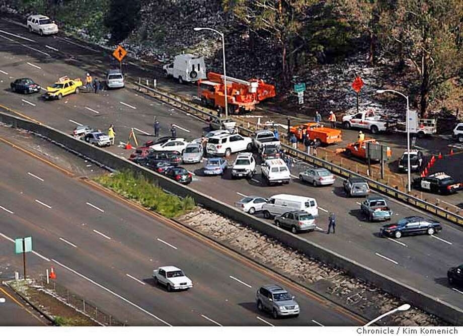 Northbound lanes of highway 101 traffic remained closed into the afternoon. Traffic was diverted onto downtown Sausalito streets after a 28-car pile-up on the Waldo Grade in Sausalito, Calif. on 3/11/06. Two passengers in one of the vehicles died in the accident which occurred at around 2:30 a.m.  KIM KOMENICH/The Chronicle Photo: KIM KOMENICH
