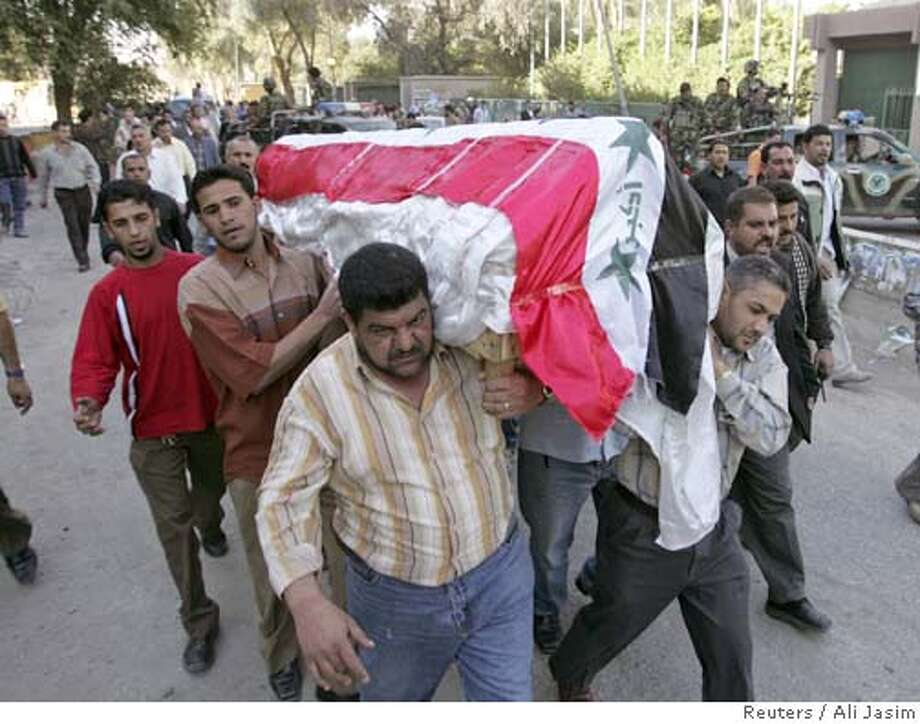 Iraqis carry the coffin of Amjad Hameed, a senior Iraqi state television editor, during his funeral in Baghdad March 11, 2006. Gunmen assassinated Hameed, along with his driver, on Saturday as they headed to work in Baghdad, police and the channel said. He was the second Iraqi journalist to be killed in a week. REUTERS/Ali JasimRan on: 03-12-2006  Iraqi men carry the coffin of Amjad Hameed, the director of the Al-Iraqiya television station, who was shot to death with his driver on their way to work Saturday in Baghdad. The story is on A10. Photo: ALI JASIM