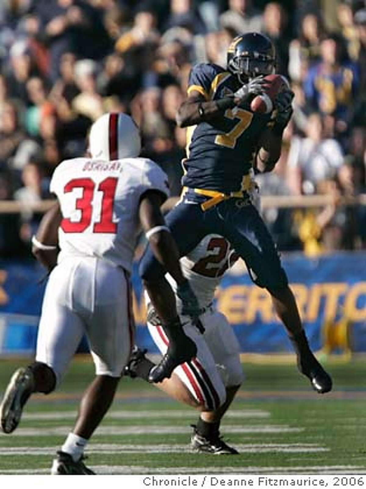 """biggame_0958_df.jpg Lavelle Hawkins makes a catch and runs for yardage. The California Golden Bears play the Stanford Cardinal at Memorial Stadium in the annual """"Big Game"""". Photographed in Berkeley on 12/2/06. (Deanne Fitzmaurice/ The Chronicle) Mandatory credit for photographer and San Francisco Chronicle. No Sales/Magazines out."""