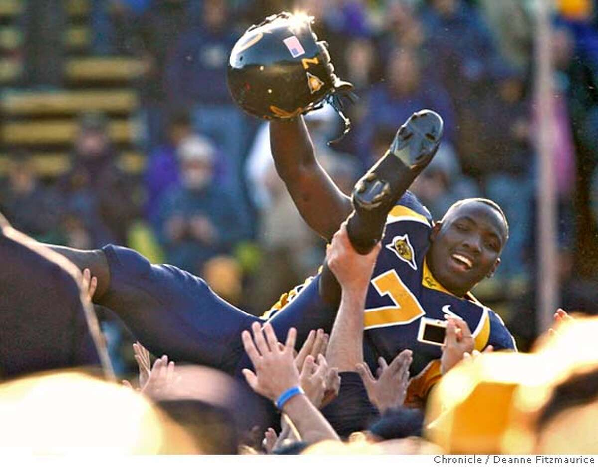 """biggame_1062_df.jpg After Cal wins, the crowed stormed the field and raised Lavelle Hawkins over their heads. The California Golden Bears play the Stanford Cardinal at Memorial Stadium in the annual """"Big Game"""". Photographed in Berkeley on 12/2/06. (Deanne Fitzmaurice/ The Chronicle) Mandatory credit for photographer and San Francisco Chronicle. No Sales/Magazines out."""