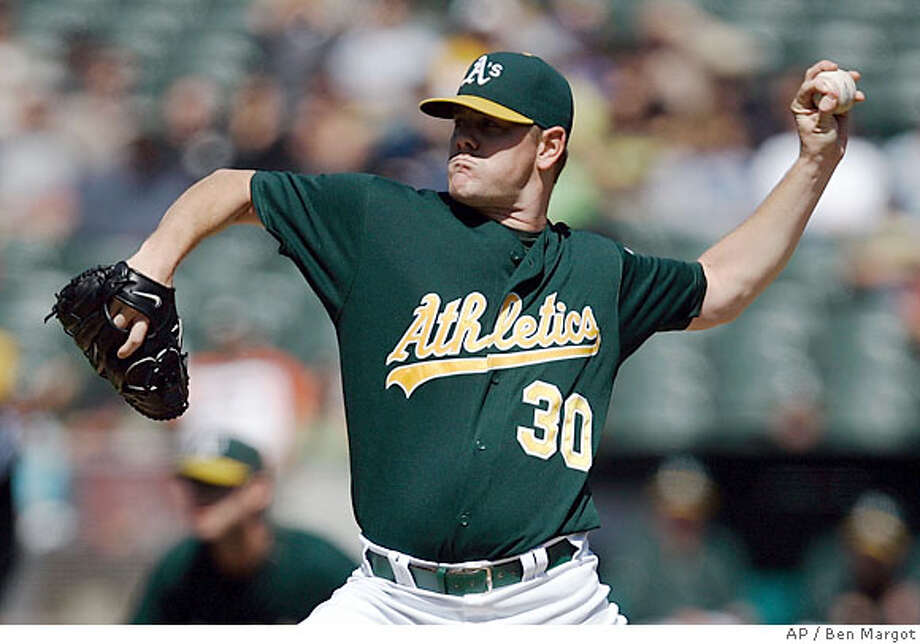 Oakland Athletics' Dan Meyer works against the Seattle Mariners in the first inning of a baseball game Wednesday, Sept. 19, 2007, in Oakland, Calif. (AP Photo/Ben Margot) Photo: Ben Margot