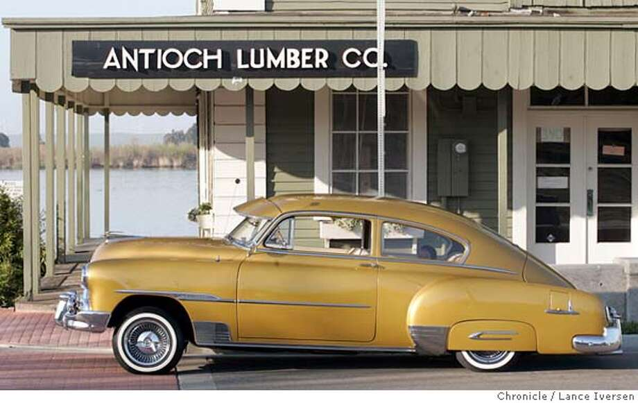 MOTORXX_LI_0058.jpg_  MOTOR-FEATURE: Raul Mendoza from Antioch spent a year and thirty thousand dollars restoring his 1951 Chevrolet Fleet Line Deluxe. Mendoza plans to keep it in the family and eventually passing it onto his children even though he has started restoring a vintage Chevrolet truck. The color is Inca Gold and the rims are by Lexor. The Gazelle hood ornament is a 24 cart gold. By Lance Iversen/San Francisco Chronicle MANDATORY CREDIT PHOTOG AND SAN FRANCISCO CHRONICLE. Photo: Lance Iversen