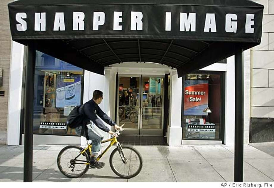 ** FILE ** A bicyclist rides past the Sharper Image store on Post street in a San Francisco file photo from Aug. 15, 2005. A major shareholder of Sharper Image Corp. on said it is seeking to take over the company's board in an effort to turn around the ailing high-end gadget retailer. (AP Photo/Eric Risberg, File) AUG. 15, 2005 FILE PHOTO Photo: ERIC RISBERG