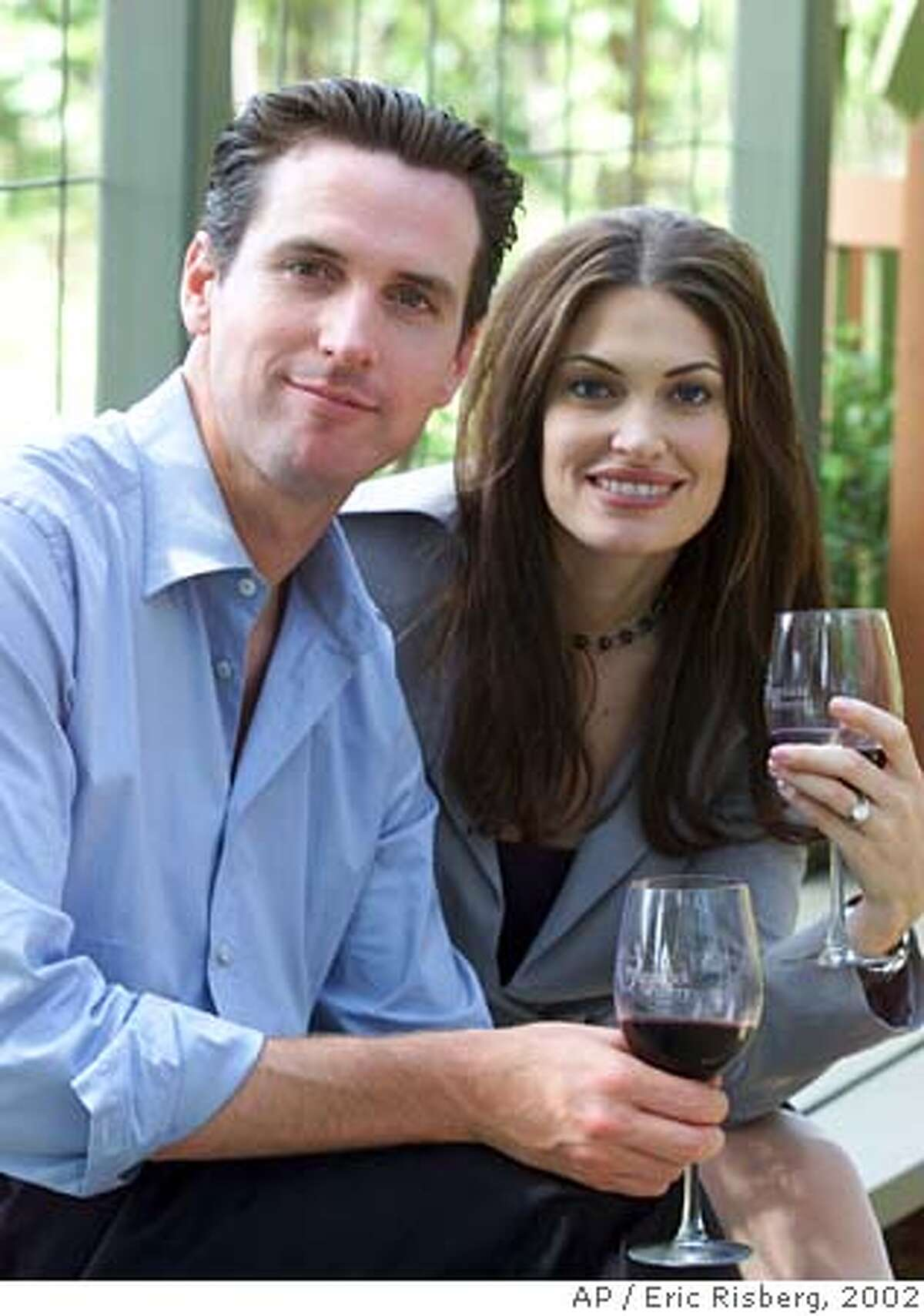 Gavin Newsom, left, and his wife, Kimberly Guilfoyle Newsom, right, pose for a picture at the PlumpJack winery in Oakville, Calif., Friday June 7, 2002. San Francisco Mayor Gavin Newsom and his wife, Court TV legal analyst Kimberly Guilfoyle Newsom, are filing for divorce after three years of marriage. In a joint statement issued Wednesday by the mayor's office, the Newsoms cited the strain posed by their high-profile, bicoastal careers as the reason for the split. (AP Photo/Eric Risberg) A JUNE 7 2002 PHOTO Ran on: 01-06-2005 Mayor Gavin Newsom and wife Kimberly Guilfoyle Newsom are getting divorced. Ran on: 01-06-2005 Mayor Gavin Newsom and wife Kimberly Guilfoyle Newsom are getting divorced. Ran on: 01-09-2005 ##Chronicle#1/6/2005####0422551537