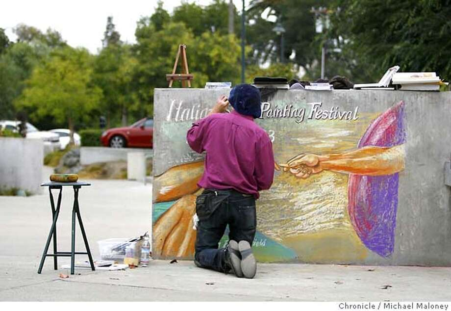 "Kean Butterfield works on his slightly altered version of Michelangelo's ""The Creation of Adam"". (He added a chalk to one of the hands) The piece will be displayed at the entrance to the plaza next weekend.  Local artist Kean Butterfield will be the featured artist at this year's Italian Street Painting Festival in downtown Martinez, CA. The Sept. 22 and 23 event draws approximately 2,000-3,000 people to watch the colorful chalk art on the plaza come to life. Photo taken on 9/12/07 in Martinez, CA  Photo by Michael Maloney / San Francisco Chronicle  ***Kean Butterfield MANDATORY CREDIT FOR PHOTOG AND SF CHRONICLE/NO SALES-MAGS OUT Photo: Michael Maloney"