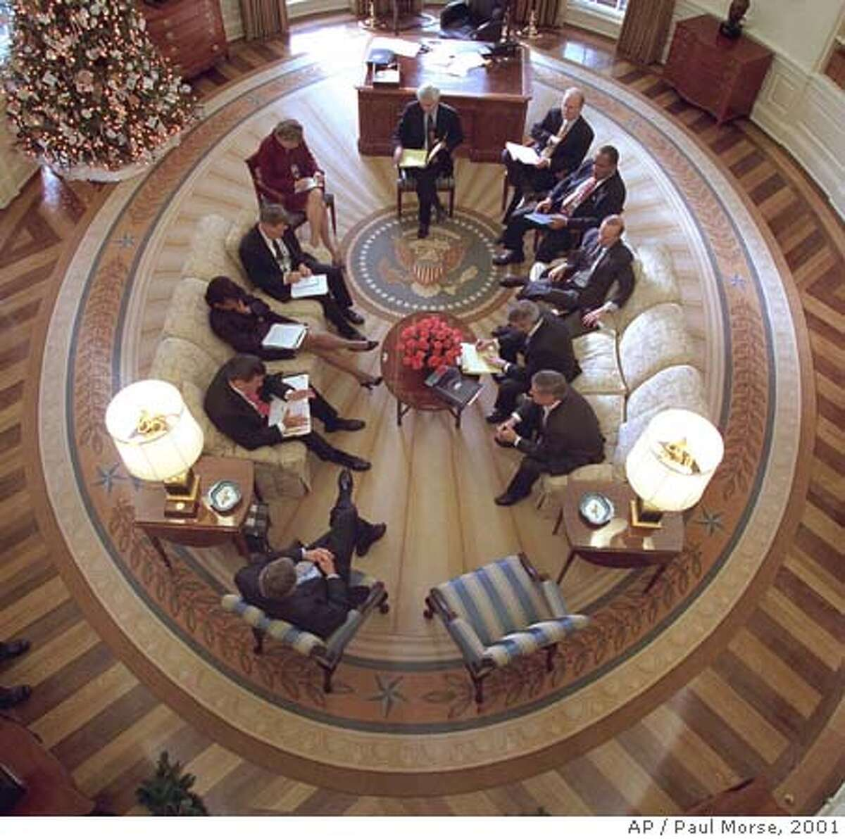 President Bush hosts a meeting in the Oval Office decorated with the new presidential rug in the White House in Washington, Thursday, Dec. 20, 2001. The rug, which is unique to the Bush administration, arrived earlier in the week and was unveiled to the media Friday Dec. 21, 2001. The participants included clockwise from the bottom, President Bush, Tom Ridge, Condoleezza Rice, Admiral Steve Abbot, Karen Hughes, Dean McGrath, Karl Rove, Albert Hawkins, Mitch Daniels, Josh Bolton, and Andy Card. WhiteHouse Photographer Paul Morse is at left. (AP Photo/White House, Paul Morse)
