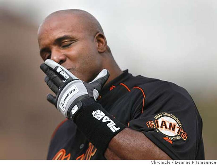 "giants_249_df.jpg  While on first base after his first hit of the Spring Training season, A woman in the stands yells, ""Someone loves you, Barry"" and he blew her a kiss and waved. Barry Bonds plays his first Spring Training game against the Los Angeles Angels as a designated hitter at Tempe Diablo Stadium.  Event was shot on 3/9/06 in Phoenix.  San Francisco Chronicle photo by Deanne Fitzmaurice Photo: Deanne Fitzmaurice"