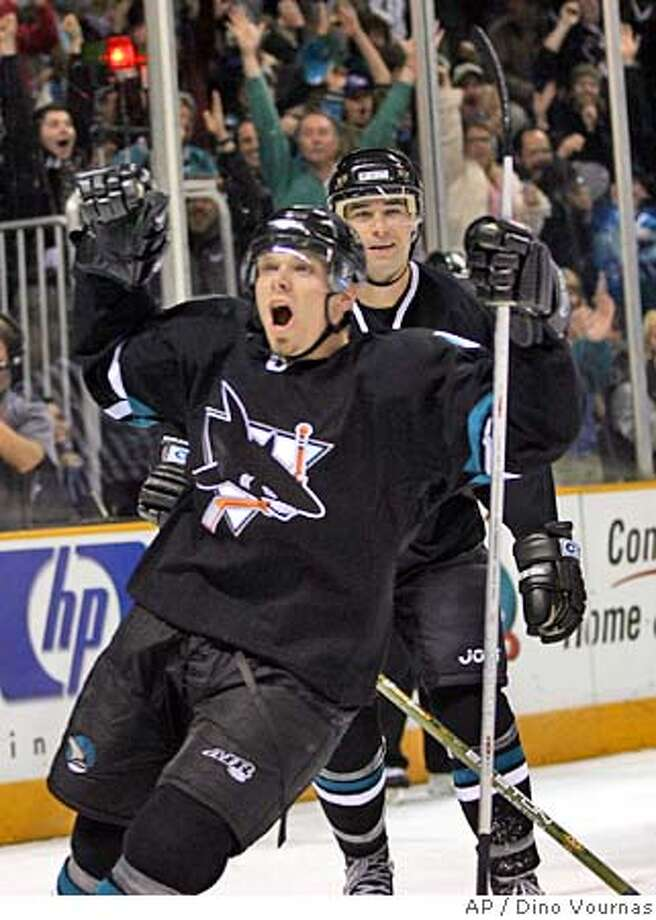 San Jose Sharks' Patrick Marleau, right, celebrates with teammate Steve Bernier, front, after Marleau tapped in a shot from Bernier past Edmonton Oilers goalie Dwayne Roloson for a goal in the second period of an NHL hockey game Thursday, March 9, 2006, in San Jose, Calif. (AP Photo/Dino Vournas) Photo: DINO VOURNAS