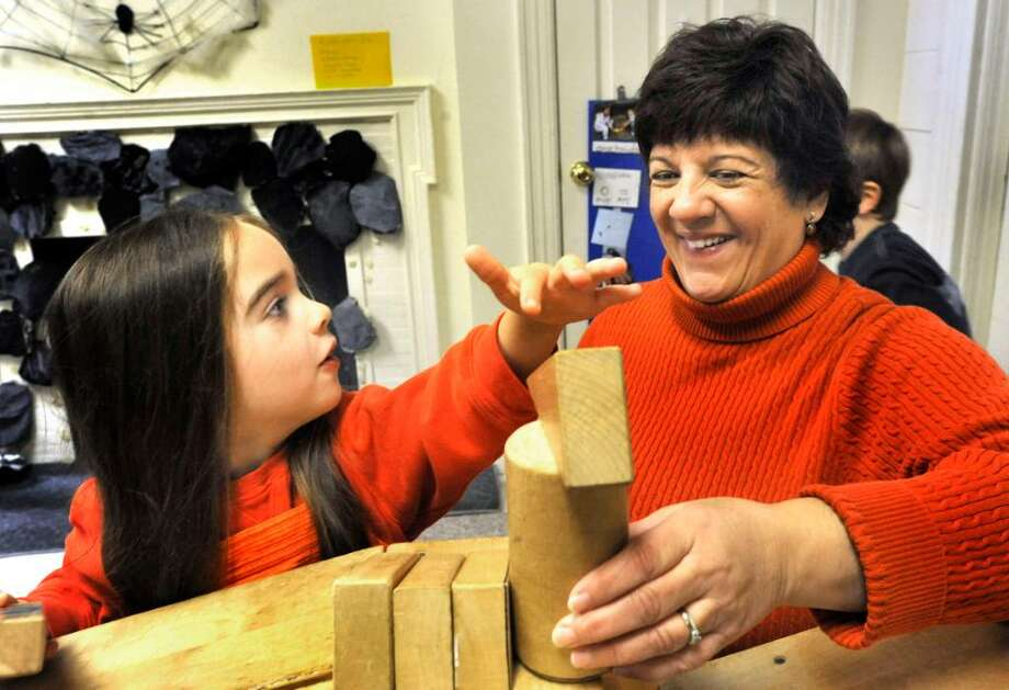Felicia Crowley, a kindergarten student at The Childern's Center in New Milford, plays blocks with Barbara Conte, Director, on Friday, Oct. 30, 2009. Photo: Michael Duffy / The News-Times