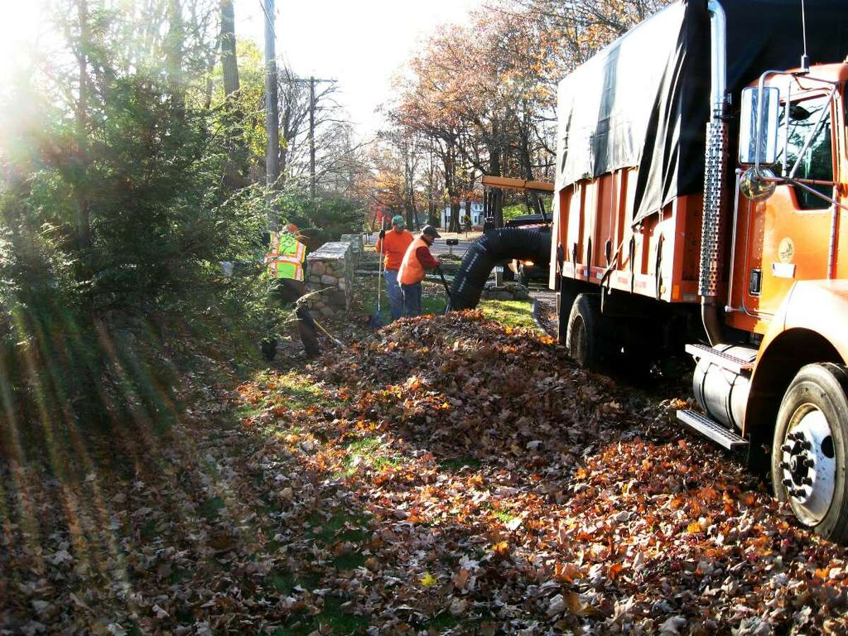 Trumbull DPW operate a leaf vacuum, which is used on busier streets that can't be closed off. Elsewhere, Payloaders and dump trucks do the leaf-pickup job, but there's still a lot of raking involved.