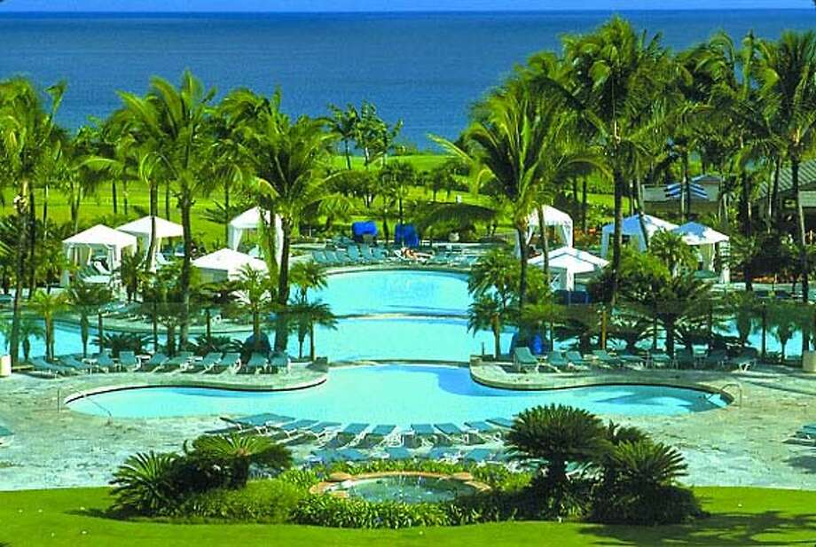 TRAVEL HAWAII RITZ-CARLTON -- The Ritz-Carlton, Kapalua, on Maui is closed while undergoing a $125 million transformation through Dec. 2007. But its 10,000-square-foot, tri-level swimming pool, as seen from the lobby, is expected to remain.  Courtesy The Ritz-Carlton, Kapalua Photo: HO