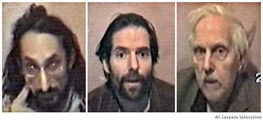 Hostages (L to R), Harmeet Sooden and James Loney, both from Canada, and Norman Kember of Britain, appear in video images taken from Al Jazeera television aired on March 7, 2006. The video showed three of four Christian peace activists held hostage in Iraq since November by a group calling itself the Swords of Truth. The station said the men had called on Gulf Arab leaders and their own governments to help free them. US OUT, GERMANY OUT, NO ONLINES, , NO ARCHIVE REUTERS/Al Jazeera television Photo: AL JAZEERA