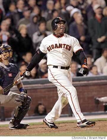 Bonds second at bat is a fly to center field to end the 3rd inning...he smiled as he watched.  Barry Bonds returned to action Monday night against the division-leading San Diego Padres. Brant Ward 9/12/05 Photo: Brant Ward