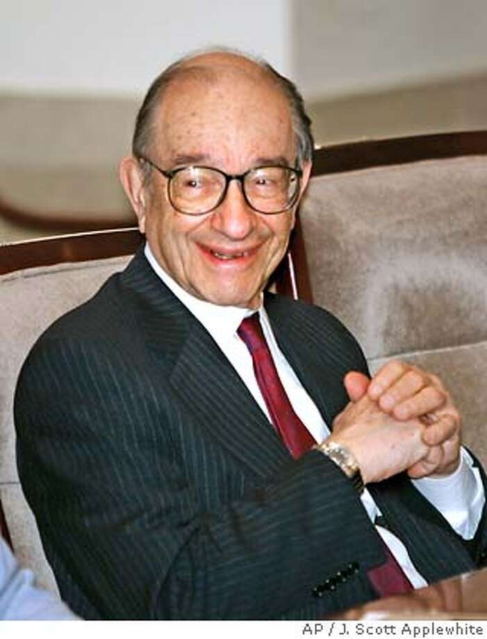 *FILE**Alan Greenspan presides over his final Federal Open Market Committee meeting nn his last day as chairman of the Board of Governors of the Federal Reserve System, at the the Federal Reserve's headquarters in Washington, on Jan. 31, 2006 . Greenspan's memoirs, one of the hottest properties in publishing, have been acquired by The Penguin Press, which has set a 2007 release date for the book by the former chairman of the Federal Reserve. Financial terms were not disclosed by Penguin, an imprint of Penguin Group (USA) that announced the deal Tuesday, March 7, 2006. (AP Photo/J. Scott Applewhite) A JAN 31 2006 FILE PHOTO