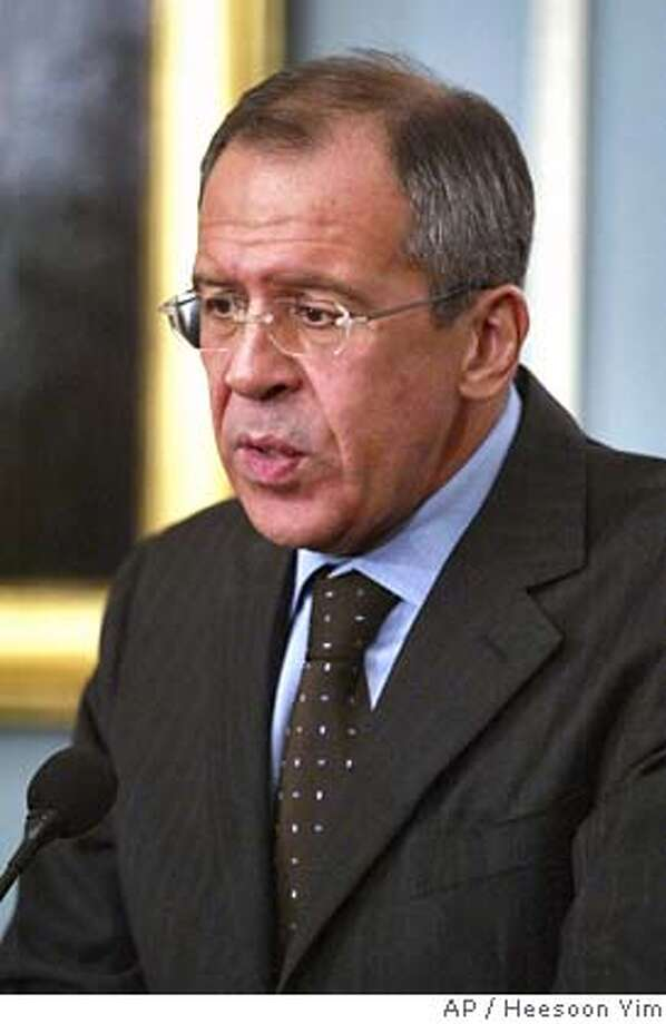 Russian Foreign Minister Sergey Lavrov answers a reporters question during his joint news conference with Secretary of State Condoleezza Rice, not shown, Tuesday, March 7, 2006 at the State Department in Washington. The Bush administration told Iran on Tuesday that any enrichment of nuclear fuel on Iranian territory was unacceptable, as Russia appeared to close ranks with the U.S. over Tehran's nuclear program. (AP Photo/Heesoon Yim) Photo: HEESOON YIM