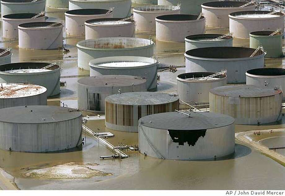 The Cheveron Pascagoula Refinery is shown flooded out by the storm surge caused by Hurricane Katrina in a Pascagoula, Miss., Tuesday, Aug. 30, 2005. (AP Photo/John David Mercer, Pool) POOL PHOTO