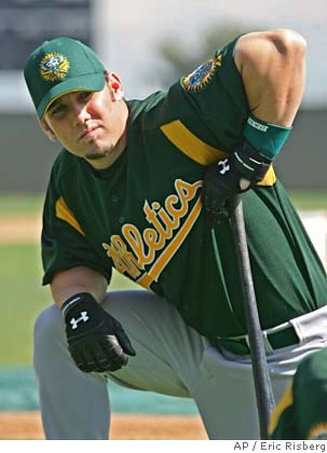 Oakland Athletics' infielder Keith Ginter takes a break during spring training in Phoenix, Ariz., Thursday Feb. 24, 2005. Ginter played last season for Milwaukee and is hoping to play at second base this season along with Mark Ellis and Marco Scutaro.(AP Photo/Eric Risberg) Ran on: 03-09-2005  Joanie Marcos Ran on: 03-09-2005  Keith Ginter, competing with Mark Ellis and Marco Scutaro for the second-base job, hit 19 homers last year with Milwaukee. Ran on: 03-09-2005  Keith Ginter, competing with Mark Ellis and Marco Scutaro for the second-base job, hit 19 homers last year with Milwaukee. Ran on: 03-09-2005  Keith Ginter, competing with Mark Ellis and Marco Scutaro for the second-base job, hit 19 homers last year with Milwaukee. Photo: ERIC RISBERG