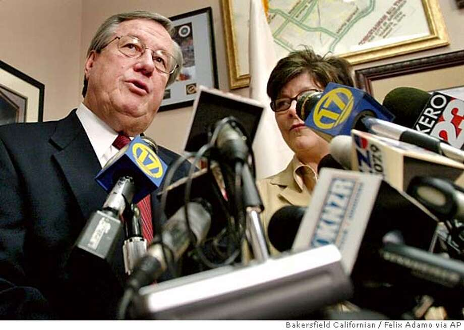 Republican Rep. Bill Thomas with his wife Sharon by his side, speak to the media during a news conference, Monday, March 6, 2006, in Bakersfield, Calif. Thomas, the powerful and mercurial chairman of the House Ways and Means Committee, announced Monday that he will retire from Congress after this year. (AP Photo/Bakersfield Californian, Felix Adamo) ** MANDATORY CREDIT, MAGS OUT, , ONLINE OUT, TV OUT ** MANDATORY CREDIT, MAGS OUT, , ONLINE OUT, TV OUT Photo: FELIX ADAMO