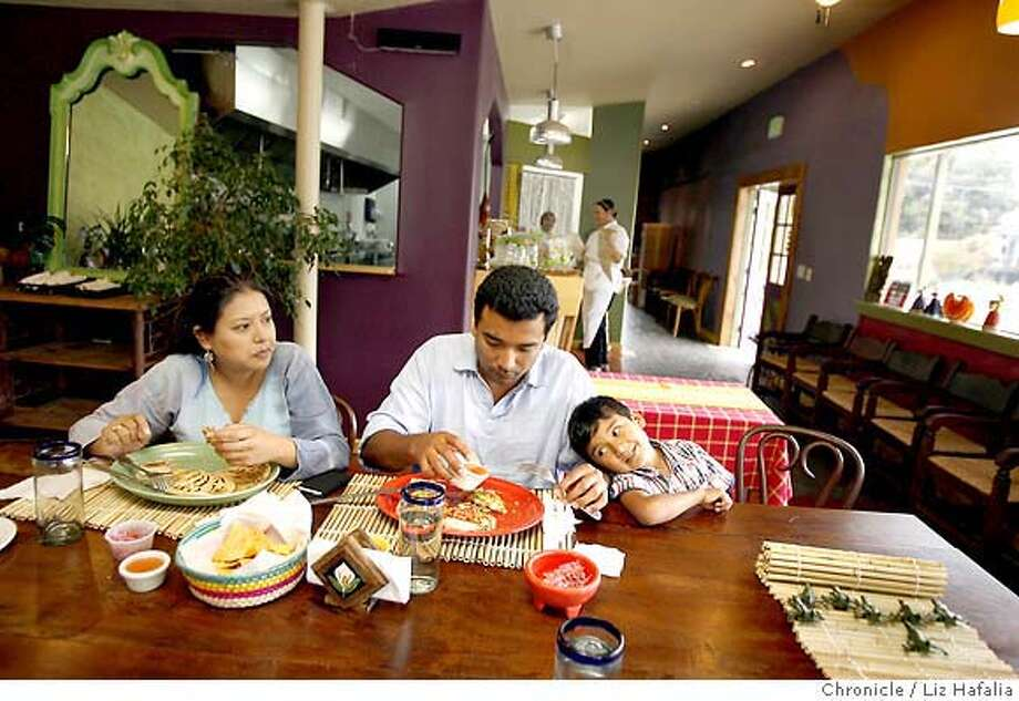 BARGAIN20_MAIZ_009_LH.JPG Left to right--Adriana Cortez, having Loroca w/pupusa, Ivan Hurtado, having a carne asada quesadilla, and their son, Ian Hurtado Cortez, 5 years old, at Maiz, a Salvadorian restaurant in Berkeley. Liz Hafalia/The Chronicle/South San Francisco/9/13/07  **Adriana Cortez, Ivan Hurtado, Ian Hurtado Cortez cq �2007, San Francisco Chronicle/ Liz Hafalia  MANDATORY CREDIT FOR PHOTOG AND SAN FRANCISCO CHRONICLE. NO SALES- MAGS OUT. Photo: Liz Hafalia