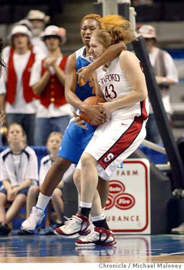 PAC10WOMEN07_122_MJM.jpg  Stanford's Kristen Newlin (#43) gets strangled by UCLA's Chinyere Ibekwe as they go after a UCLA rebound in the 1st half.  Stanford Cardinal vs UCLA Bruins in the 2006 Pac 10 Women's Basketball Championship game at HP Pavillion.  Photo by Michael Maloney / San Francisco Chronicle on 3/6/06 in San Jose,CARan on: 03-07-2006  Photo caption Ran on: 03-07-2006  Chinyere Ibekwe has Stanford's Kristen Newlin in a headlock, while UCLA had the Cardinal in its grip.Ran on: 03-07-2006  Chinyere Ibekwe has Stanford's Kristen Newlin in a headlock, while UCLA had the Cardinal in its grip. Photo: Michael Maloney