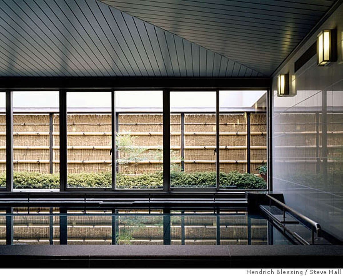 The women's ofuro has glossy white tile walls, granite pools and limestone flooring. The idea: Let the Japanese garden view rule, said interior architect Gerry Jue. Hedrich Blessing photo by Steve Hall