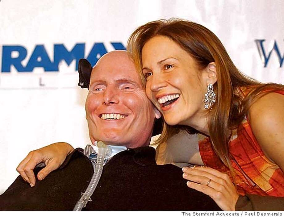 **FILE** Christopher Reeve and his wife, Dana, pose on their way into a gala benefit in Greenwich, Conn. in this Thursday night, Oct. 9, 2003 file photo, that raised $1.5 million for the Westport (Conn.) Playhouse's $30 million renovation project. Dana Reeve, who fought for better treatments and possible cures for paralysis through the Christopher Reeve Foundation, named for her late actor-husband, has died, the foundation said. She was 44. Reeve died late Monday of lung cancer, said Kathy Lewis, President and CEO of the foundation. (AP Photo/The Stamford Advocate, Paul Desmarais, File) AN OCT. 9, 2003 FILE PHOTO Photo: PAUL DESMARAIS