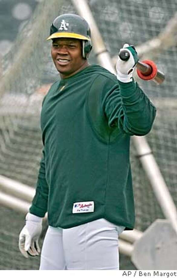 Oakland Athletics' Frank Thomas bats prior to the spring training baseball game with the Chicago Cubs, Monday, March 6, 2006, in Phoenix. (AP Photo/Ben Margot) EFE OUT Photo: BEN MARGOT