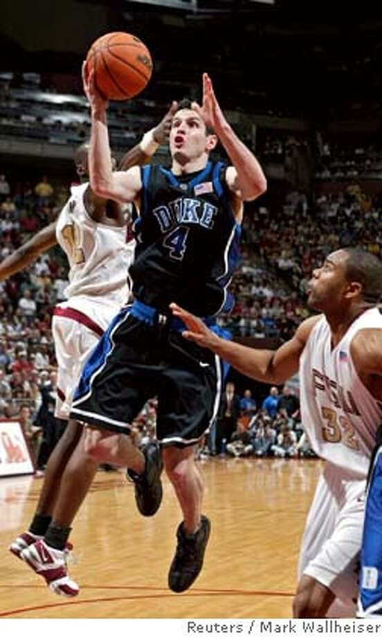 Duke's J.J. Redick (4) cuts between Florida State defenders, Al Thornton (L) and Alexander Johnson (32) for two of his 30 points in Duke's 79-72 loss to unranked Florida State during their NCAA basketball game in Tallahassee, Florida March 1, 2006. REUTERS/Mark Wallheiser Photo: MARK WALLHEISER