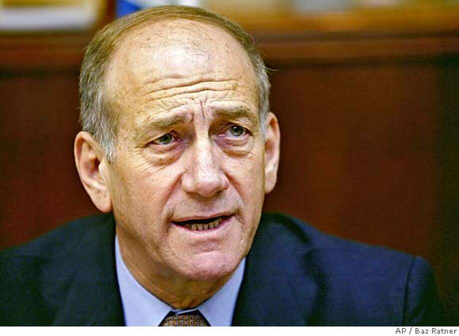 Israeli acting Prime Minister Ehud Olmert, attends a weekly cabinet meeting in Jerusalem Sunday March. 5, 2006. Olmert called on religious leaders Sunday to show restraint and help defuse tensions after this weekend's church riots in Nazareth, where an Israeli family set off small explosives late Friday in the Basilica of the Annunciation, leading to a tense standoff with hundreds of angry Arab residents of Nazareth. (AP Photo/Baz Ratner, Pool) POOL PHOTO Photo: BAZ RATNER