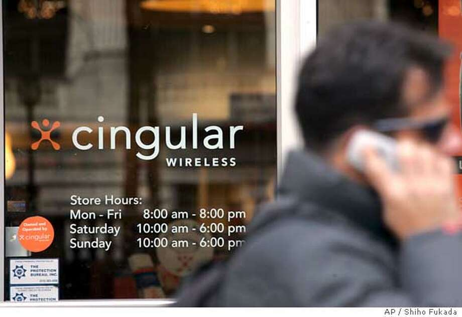 A man walks by a Cingular store Monday, March 6, 2006 in New York. Cingular Wireless LLC, a joint venture of AT&T and BellSouth, is the nation's largest cell phone provider. AT&T has offered $67 billion to acquire BellSouth. (AP Photo/Shiho Fukada) Photo: SHIHO FUKADA
