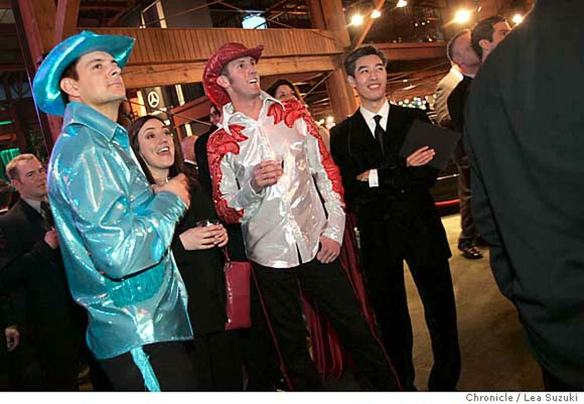 academyparty_053_ls.JPG from left: Brian Lammers of SF, Stephanie Infantino of SF, Jason Dorn of SF and Hao Le of Mountain View react to the winner of Best Supporting Actress category at the Academy of Friends party at Concourse Exhibition Center. Academy of Friends Party. Bunch of people together to watch Academy Awards at Concourse Exhibition Center. Goes on for a while. It's a big deal this year because of Brokeback Mountain. Lots of gay men there very excited about the nomination. Men painted golden serving drinks. LEA--Need photo by 9:30pm. Editor will presume photo is horizontal. Photo taken on 3/5/06 in San Francisco, CA. Photo by Lea Suzuki/ The San Francisco ChronicleRan on: 03-06-2006 From left: Brian Lammers, Stephanie Infantino and Jason Dorn, all of San Francisco, and Hao Le of Mountain View at the Oscar party at the Concourse Exhibition Center.Ran on: 03-06-2006 From left: Brian Lammers, Stephanie Infantino and Jason Dorn, all of San Francisco, and Hao Le of Mountain View attend the Oscar party at the Concourse Exhibition Center.
