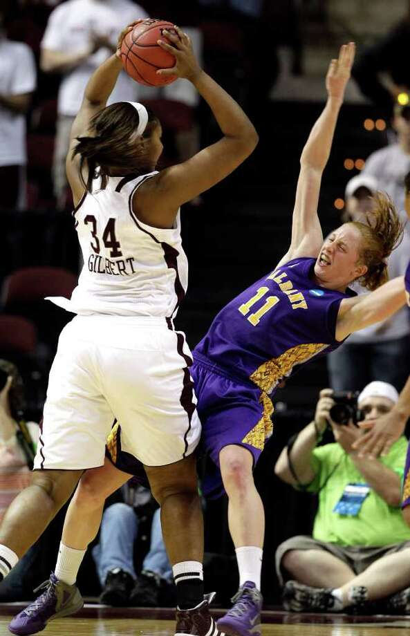 Texas A&M's Karla Gilbert (34) charges into Albany's Julie Forster (11) during the second half of an NCAA tournament first-round women's college basketball game, Saturday, March 17, 2012, in College Station, Texas. Texas A&M defeated Albany 69-47.  (AP Photo/David J. Phillip) Photo: David J. Phillip