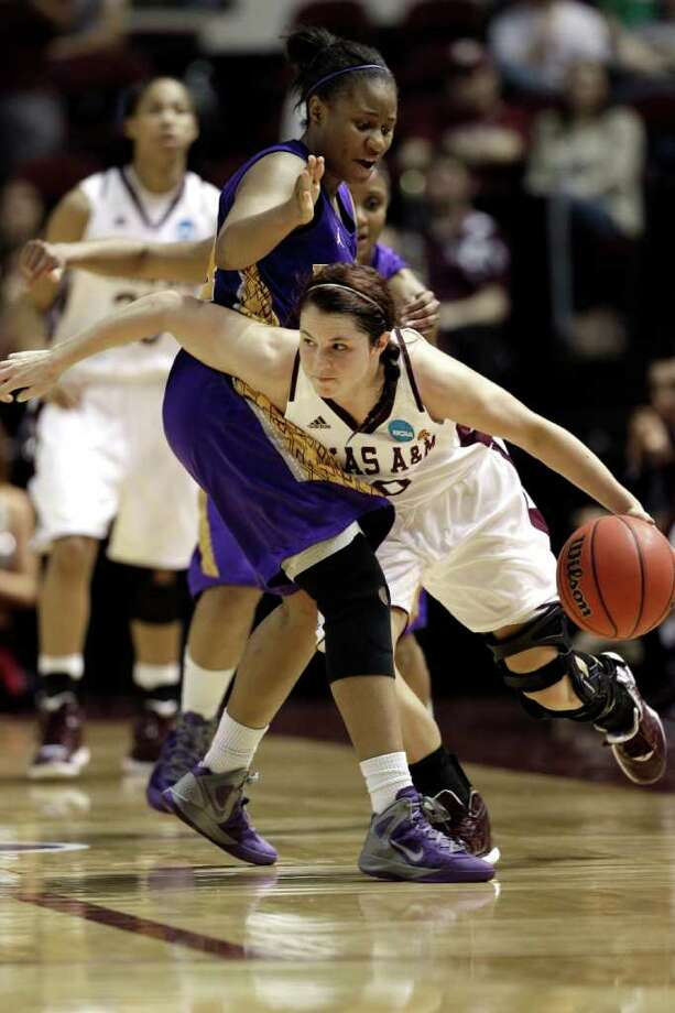 Texas A&M's Alexia Standish (10) drives around Albany's Adrienne Jones, left, during the second half of an NCAA tournament first-round women's college basketball game, Saturday, March 17, 2012, in College Station, Texas. Texas A&M defeated Albany 69-47.  (AP Photo/David J. Phillip) Photo: David J. Phillip