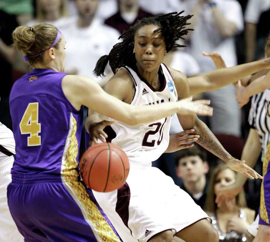 Albany's Sarah Royals (4) knocks the ball loose from Texas A&M's Tyra White (20) during the second half of an NCAA tournament first-round college basketball game on Saturday, March 17, 2012, in College Station, Texas. Texas A&M defeated Albany 69-47.  (AP Photo/David J. Phillip) Photo: David J. Phillip